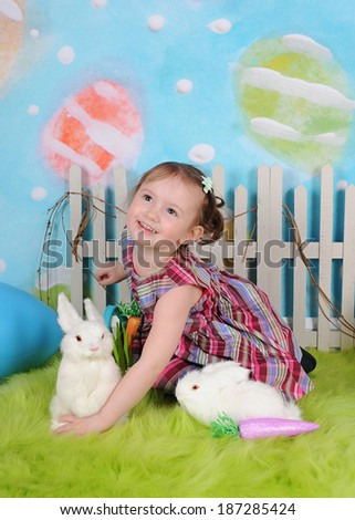 sweet girl with bunnies excited for easter - stock photo