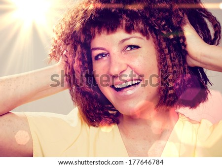 sweet girl with creped hair and lots of freckles - stock photo