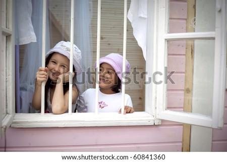 Sweet girlfriends on the window - stock photo
