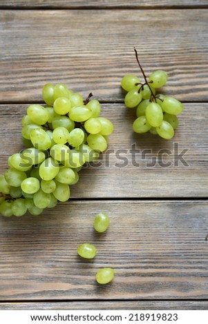 Sweet grapes on wooden boards, top view