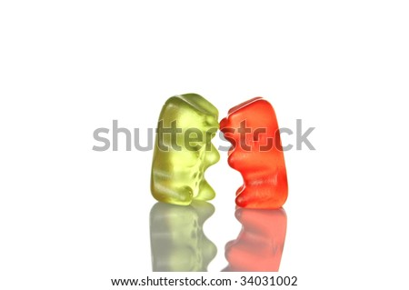sweet gummy bears dancing on a party on white background - stock photo