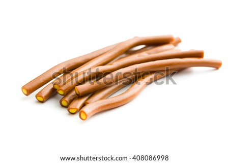 Sweet gummy sticks with cola flavor. Tasty candies isolated on white background. - stock photo