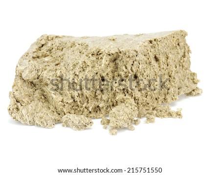 Sweet halva on a white background   - stock photo