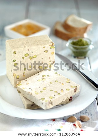sweet halva with pistachio - stock photo