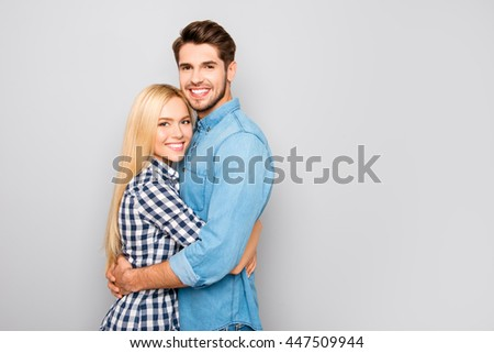 sweet happy cute couple in love hugs and smiling