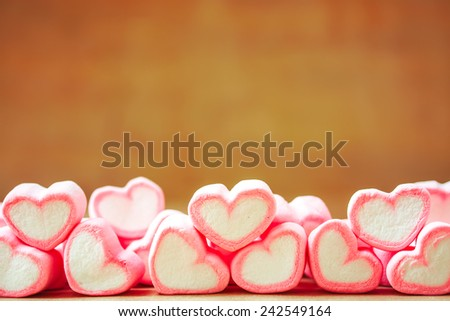 sweet heart shape of marshmallows with note book on wooden background,decoration for love and valentine day concept. - stock photo