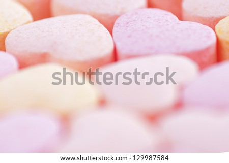 Sweet hearts shaped pink and orange Sugar Pills on white background. Soft Focus. - stock photo