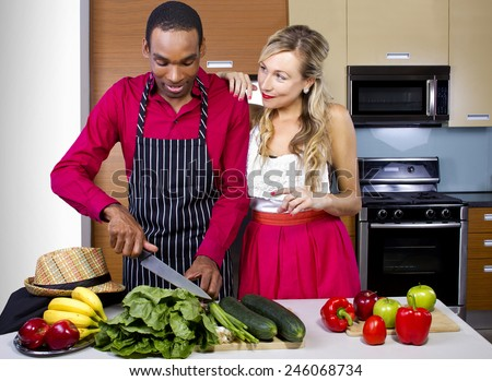 sweet helpful boyfriend cooking for girlfriend at home - stock photo