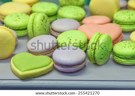 Sweet holiday buffet with vivid macarons and biscuit heats - stock photo