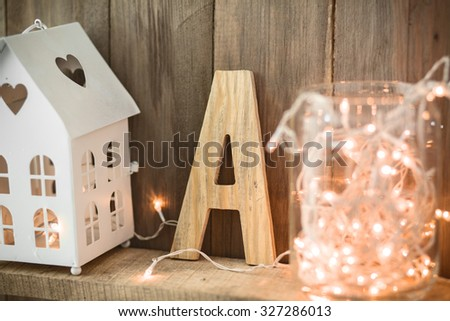 Sweet home. White Christmas decor on vintage natural wooden background.
