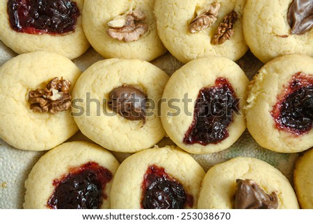 Sweet homemade pastries with jam, chocolate, and pecan - stock photo
