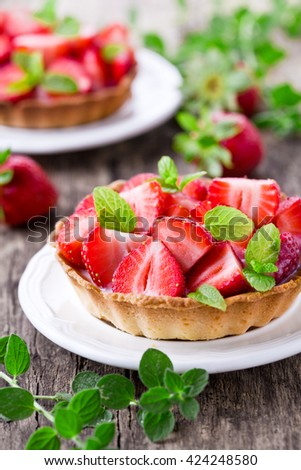 Sweet homemade strawberry pies with fresh mint leaves