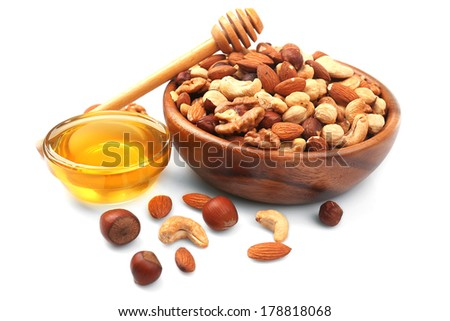 Sweet honey and different nuts, isolated on white - stock photo