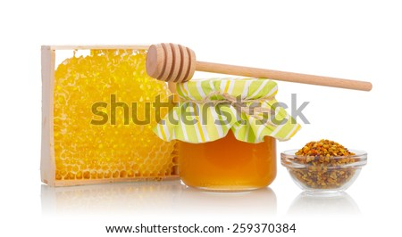 Sweet honey and honeycomb with dipper - stock photo