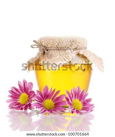 Sweet honey in jar isolated on white - stock photo
