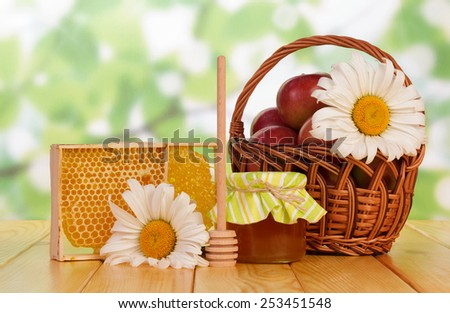 Sweet honey with honey dipper and flowers - stock photo