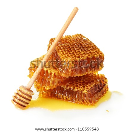 sweet honeycomb and wooden drizzler, isolated on white - stock photo