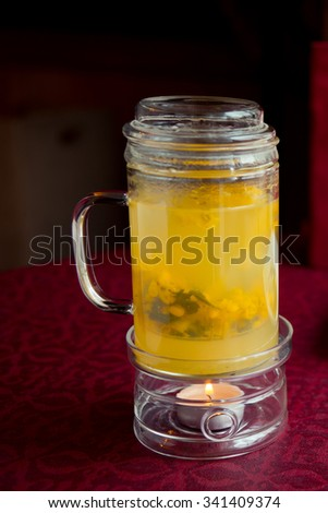 Sweet hot sea-buckthorn drink - stock photo
