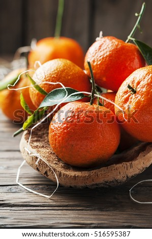 Sweet italian mandarins on the wooden table, selective focus