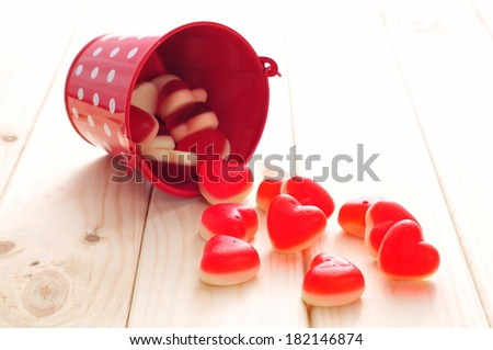 Sweet jelly candies in shape of heart in red bucket  - stock photo