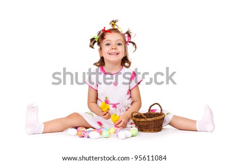 Sweet kid playing with Easter eggs - stock photo