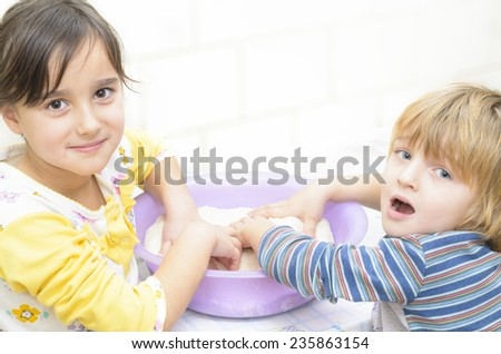 Sweet Kids playing in the kitchen - stock photo