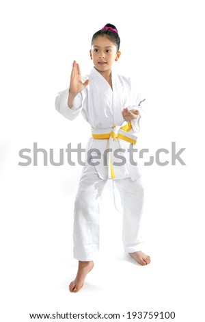 sweet latin little girl in martial arts practice like karate kid alone isolated on white background