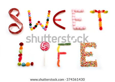 sweet life words made of candies on white background - stock photo