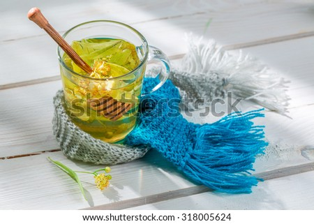 Sweet linden tea with honey - stock photo