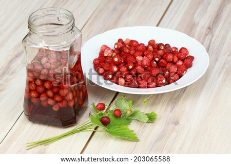 Sweet liqueur from wild strawberries  - stock photo