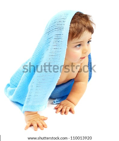 Sweet little baby boy covered blue towel, adorable child isolated on white background, cute small kid sitting indoor, healthy lifestyle, happy childhood concept - stock photo