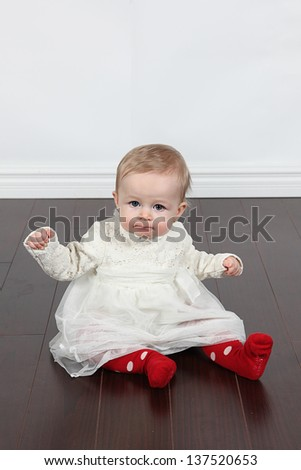 Sweet little baby girl in studio posing for the camera