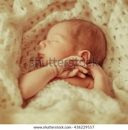 sweet  little baby sleeping on a white cloth