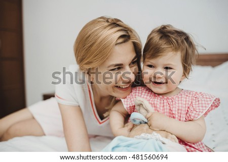 Sweet little daughter with her mother