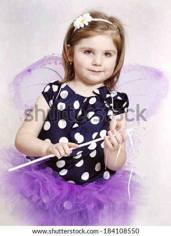 Sweet little fairy with butterfly wings and magic wand - stock photo