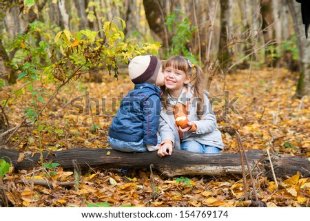 sweet little girl and boy have a date in beautiful park