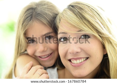 Sweet little girl cuddling with her mom