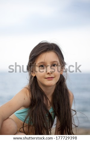 Sweet little girl on the beach