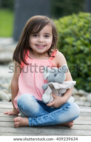 Sweet little girl outdoors playing - stock photo