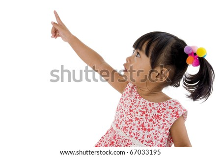 sweet little girl pointing at something, isolated on white background - stock photo