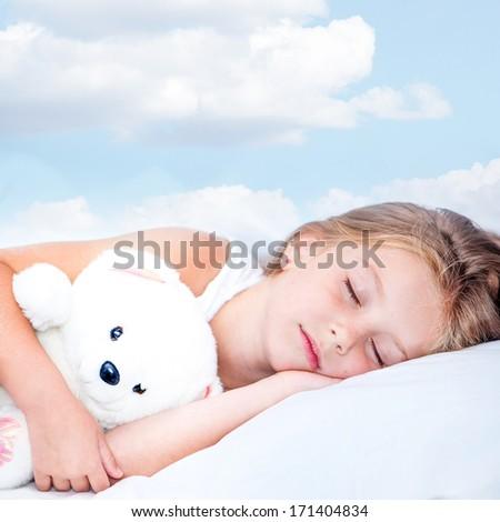 sweet little girl sleeping in her little bed - stock photo