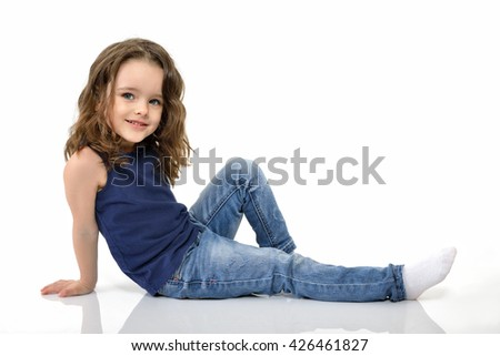 Sweet little girl, studio portrait over white background