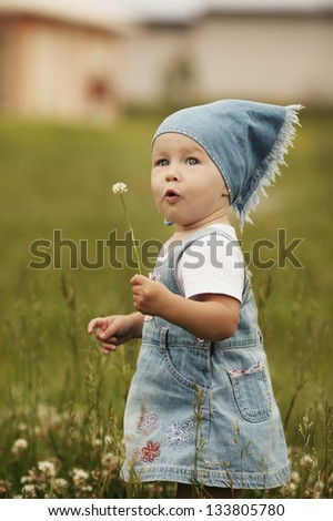 sweet little girl with flower - stock photo