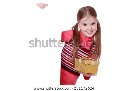 Sweet little girl with present box as a gift for Christmas and birthday - stock photo