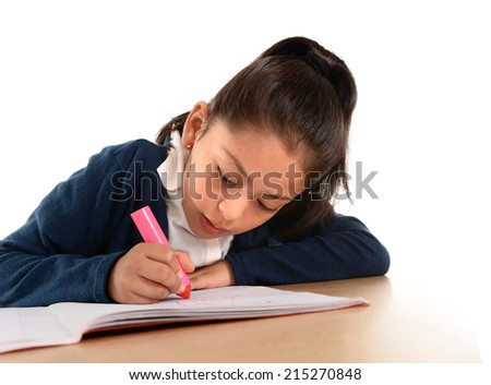 sweet little hispanic female child writing and doing homework with pink marker concentrated in children education and back to school concept isolated on white background - stock photo