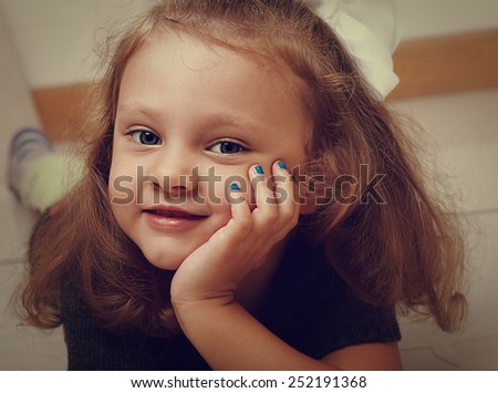 Sweet long hair kid girl with happy smiling looking. Vintage closeup portrait - stock photo