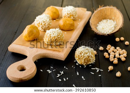 Sweet made with coconut and chickpea fluor. Ladoo, Bundi Laddu. Traditional festival sweets of India - stock photo