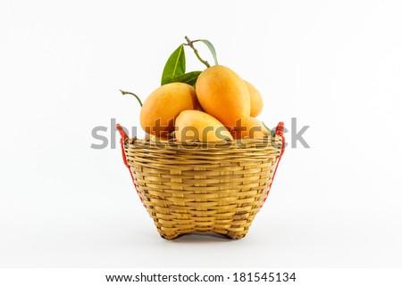 Sweet Marian plum fruit in basket on white background(Mayongchid Maprang Marian Plum and Plum Mango,thailand). - stock photo