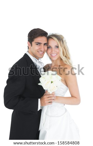 Sweet married couple posing holding a white bouquet on white background - stock photo