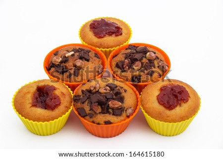 Sweet Muffins in baskets, isolated on white  - stock photo
